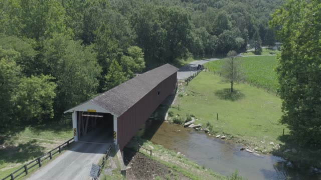 Aerial View of a Covered Bridge in Amish Countryside