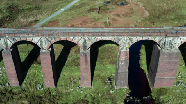 Aerial view of a disused viaduct in remote Scottish countryside