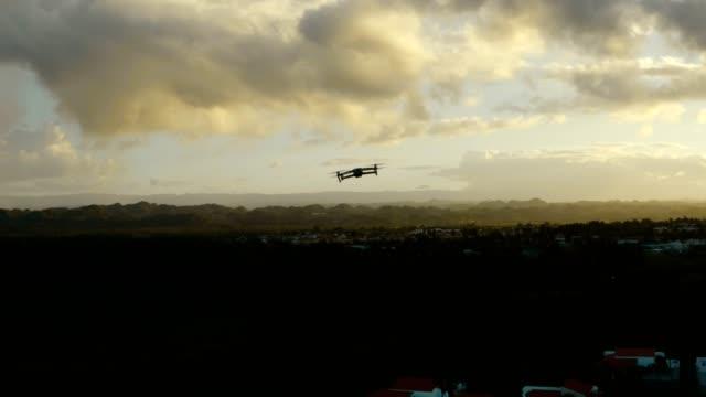 aerial view of a drone in flight. - telecomando background video stock e b–roll