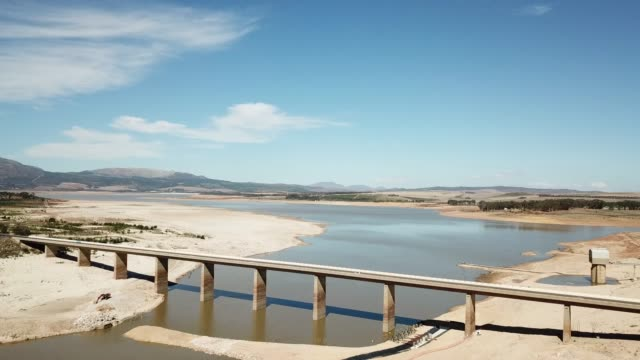 Aerial view of a drought-stricken dam in South Africa Theewaterskloof dam in the Western Cape, South Africa struggling through it's worst drought ever western cape province stock videos & royalty-free footage