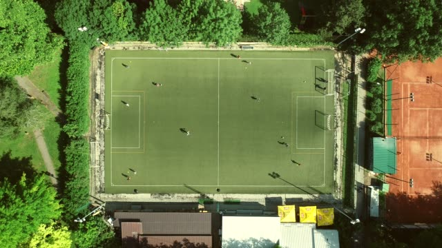 aerial view of a football training in a football pitch on a summer day. - campionato video stock e b–roll