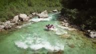 istock Aerial view of a group in a rafting boat going through the rocks at Soca River. 996832596