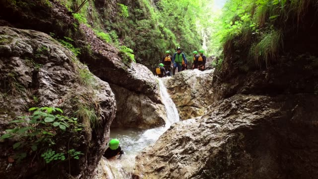 Aerial view of a group of people canyoning in Soca river, Slovenia
