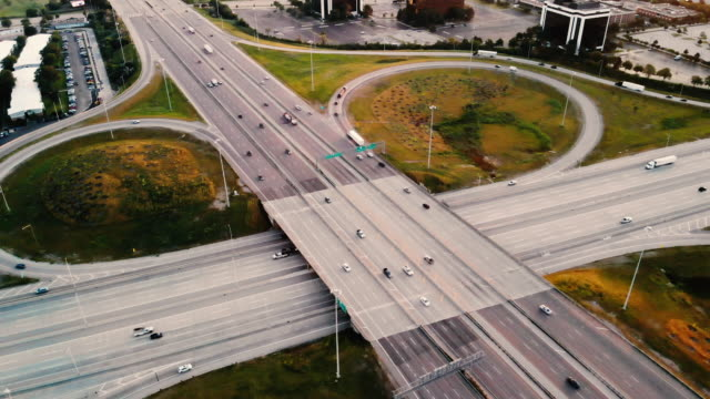Aerial View of a Highway Intersection Aerial View of a Highway Intersection chicago architecture stock videos & royalty-free footage