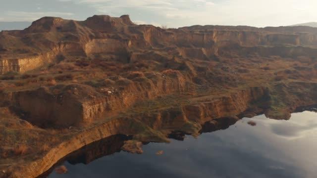 aerial view of a lake and arid landscape - турция стоковые видео и кадры b-roll