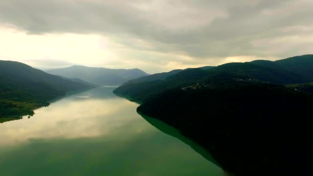 Aerial view of a large river and high mountains. Georgia