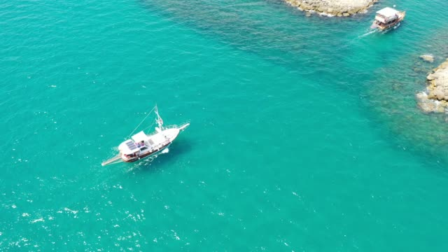 Aerial view of a little yacht on the entrance of marina