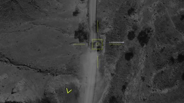 Aerial view of a military drone takes aim at a tank shoots and misses it