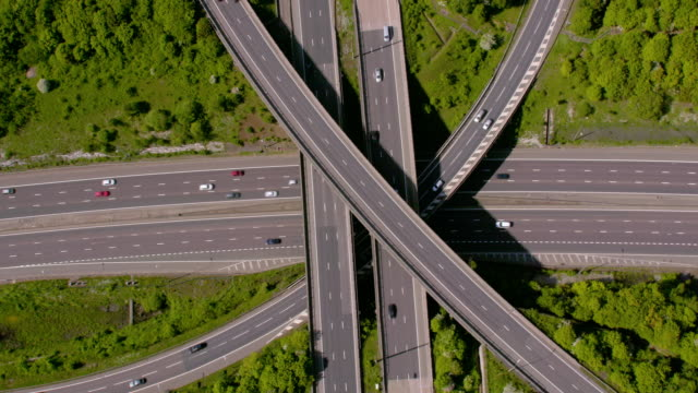 aerial view of a motorway junction m25 m40, uk. 4k - road signs stock videos and b-roll footage