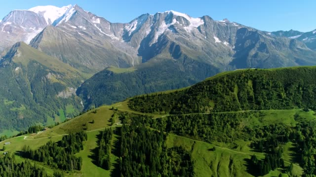 Aerial view of a mountain range in the Alps, with the peak of Mont Blanc under the blue sky - France