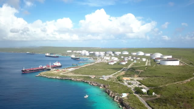 4K Aerial View of a Oil Rafinery and Fuel Storage Tank 4K Video Aerial View of a Oil Rafinery and Fuel Storage Tank With Oil Tankers in Curacao curaçao stock videos & royalty-free footage