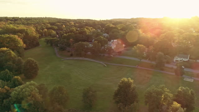 Aerial view of a park and residential area in Springfield, New Jersey, USA, at sunset. Drone video with the panoramic camera motion.