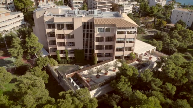 Aerial view of a residential building, surrounded by trees in Greece. Aerial view of a residential building, surrounded by trees in Greece. aegean islands stock videos & royalty-free footage