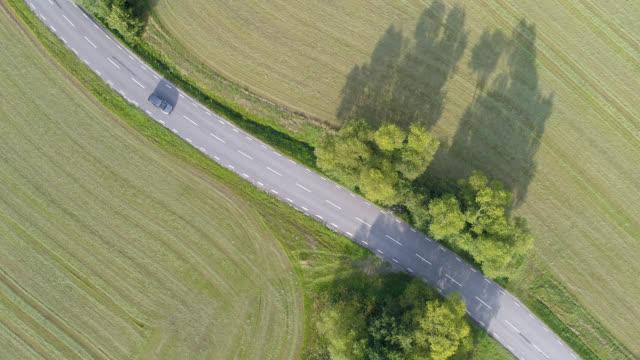 aerial view of a road - wiejska droga filmów i materiałów b-roll