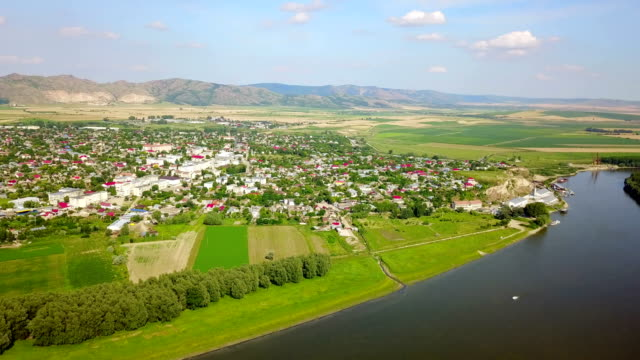Aerial view of a small town in the Balkans and the Danube video