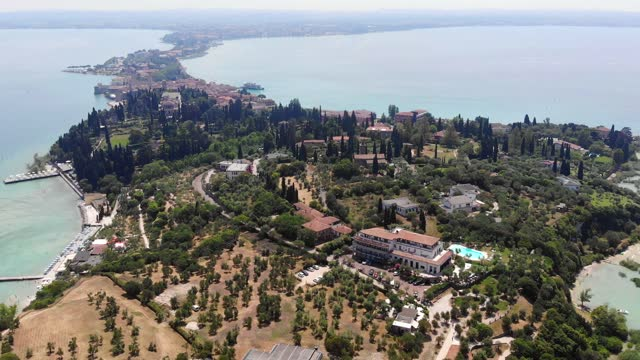 Aerial View Of A Small Town On The Peninsula (Sirmione, Italy)