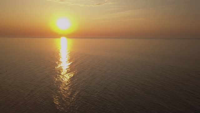 aerial view of a sunrise sky background. aerial dramatic gold sunrise with morning sky clouds over the sea. stunning sky clouds in the sunrise. aerial videography. 4k. - молдавия стоковые видео и кадры b-roll