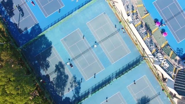 stockvideo's en b-roll-footage met luchtfoto van een tennisbanen in china - tennis