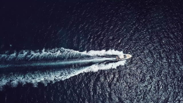 aerial view of a yachts who is sailing on an emerald and transparent mediterranean sea. emerard coast (costa smeralda), sardinia, italy. - affluent lifestyles stock videos & royalty-free footage