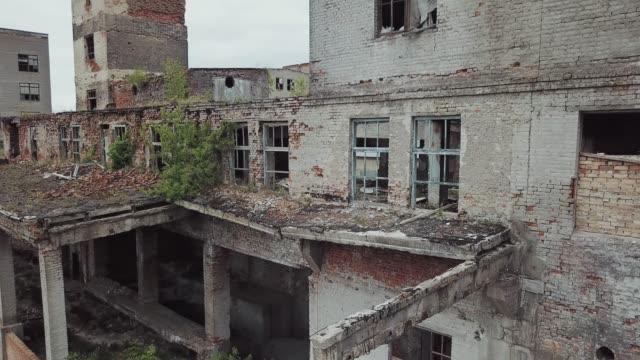 Aerial view of abandoned industrial buildings.