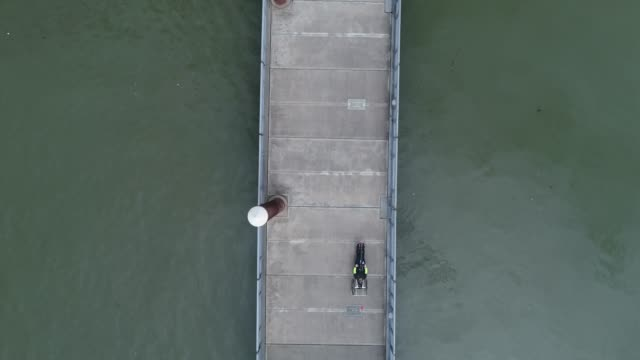 Aerial View of Adaptive Athlete Riding a Hand Powered Cycle on Floating Walkway video
