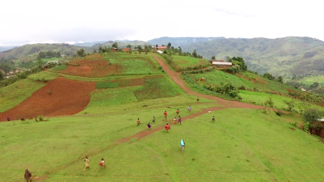 aerial view of african children running - bambine africa video stock e b–roll