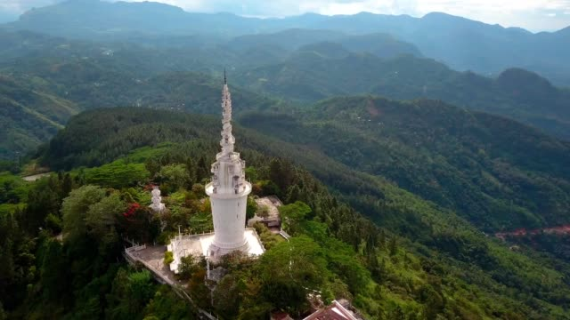 Aerial view of Ambuluwawa temple in Sri-Lanka, beautiful landscape with green mountains Aerial view of Ambuluwawa temple in Sri-Lanka, beautiful landscape with green mountains and blue sky sri lanka stock videos & royalty-free footage