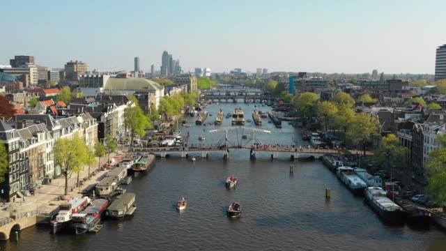 aerial view of amstel river and magere brug bridge - amsterdam video stock e b–roll