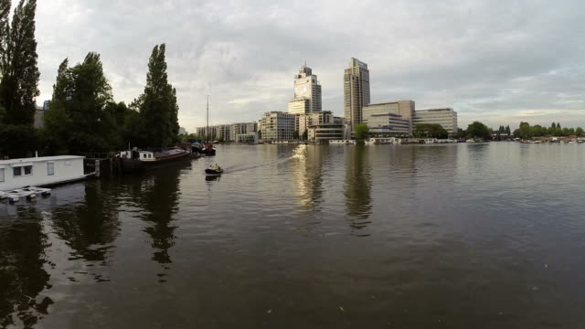 Aerial view of Amsterdam city river skyline video