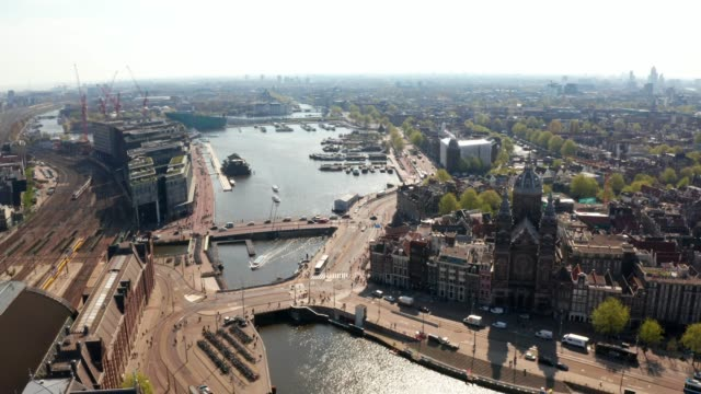 aerial view of Amsterdam over canals Beautiful aerial view of Amsterdam over canals near Central station and St. Nicolas Church dutch architecture stock videos & royalty-free footage