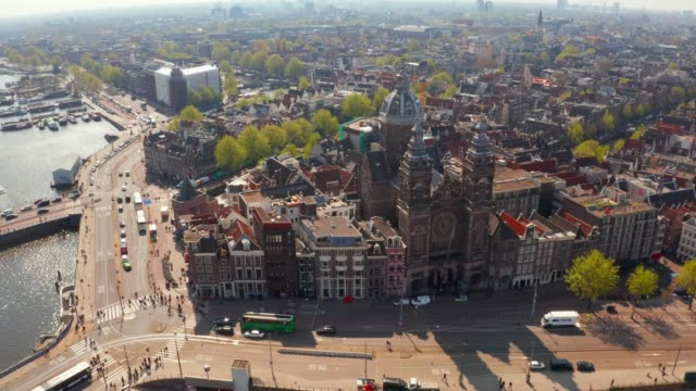 aerial view of amsterdam over canals - amsterdam video stock e b–roll