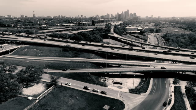 Aerial View of Austin Texas Skyline West looking Over the Mopac Expressway and Urban Landscape of the Central Texas Capital City Normal Speed with Hipster Effect