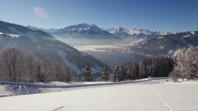 vídeos de stock, filmes e b-roll de vista aérea de áustria em um dia de inverno - tyrol state austria