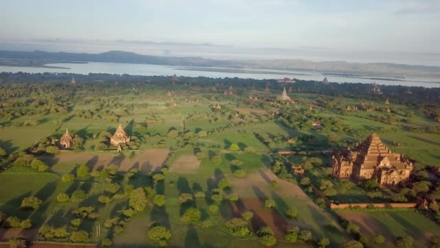 Aerial view of Bagan archeological zone, Myanmar Drone shot aerial view of Bagan archeological zone with ancient temples buddhist religion in greenery landscape shot in 4K resolution October nature travel destinations concept bagan stock videos & royalty-free footage