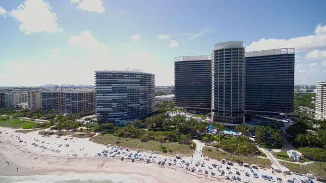 Aerial view of Bal Harbour and Surfside, Miami, from the beach and the ocean. Drone-made clip with forwarding camera motion. Aerial view of Bal Harbour and Surfside, Miami, Florida. 4K UHD B-Roll footage. ocean front properties stock videos & royalty-free footage