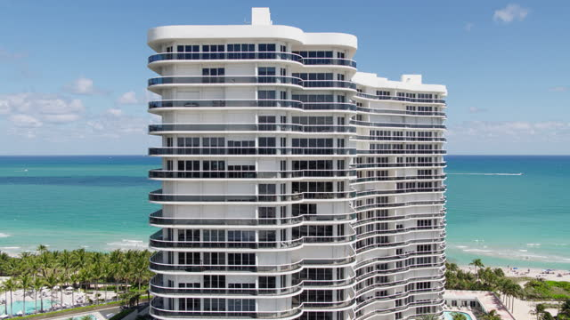 Aerial view of Bal Harbour and Surfside, Miami, toward the ocean. Drone-made clip with backward camera motion. Aerial view of Bal Harbour and Surfside, Miami, Florida. 4K UHD B-Roll footage. ocean front properties stock videos & royalty-free footage
