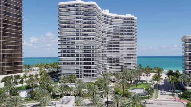 Aerial view of Bal Harbour and Surfside, Miami, toward the ocean. Drone-made clip with forwarding camera motion. Aerial view of Bal Harbour and Surfside, Miami, Florida. 4K UHD B-Roll footage. ocean front properties stock videos & royalty-free footage