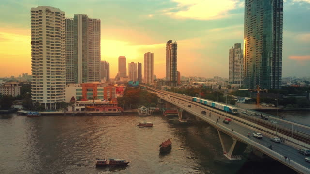 aerial view of bangkok riverside downtown at sunset - fiume chao phraya video stock e b–roll