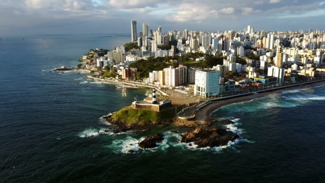 Aerial view of Barra lighthouse and the cityscape, Bahia, Brazil video