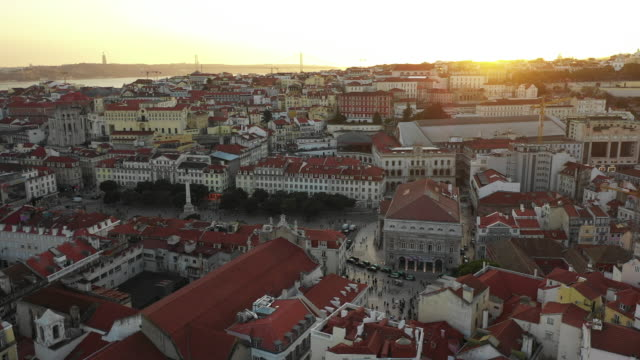 Aerial view of Baxia district in Lisbon during sunset Aerial view of Baxia district in Lisbon during sunset ponte 25 de abril stock videos & royalty-free footage