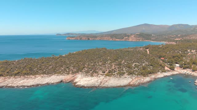Aerial view of beautiful beach on the Greek island, coastline with turquoise sea Aerial view of beautiful small st.Anna beach on the Greek island Thassos, rocky coastline with turquoise sea aegean sea stock videos & royalty-free footage