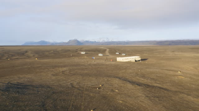 Aerial view of beautiful black beach scenery with view to old crashed plane in Iceland video