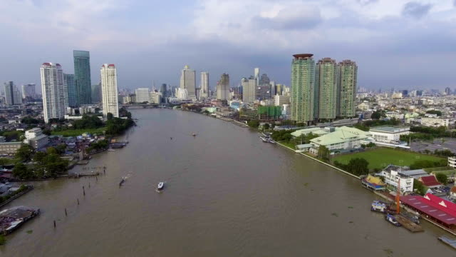 Aerial View of Beautiful Cityscape and Boats in Chaopraya River at Dusk. video