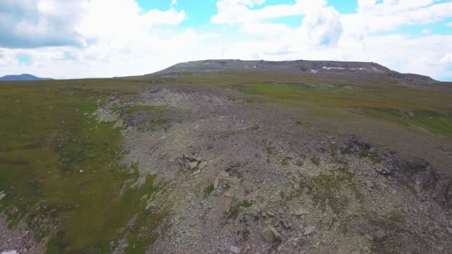 Aerial view Of Beautiful Mountain Range Fly Over High Cliffs. Shot. Rocks Epic Scale High Altitude Nature Landscape Beauty Background Extreme Altitude Drone