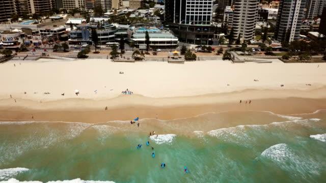 Aerial view of beautiful, rocky coast. City skyline video