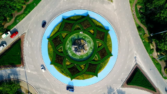 Aerial view of beautiful roundabout road green garden in Royal Park Rajapruek garden (International Horticulture Exposition Royal Flora Ratchapruek) , Chiang Mai , Thailand. video