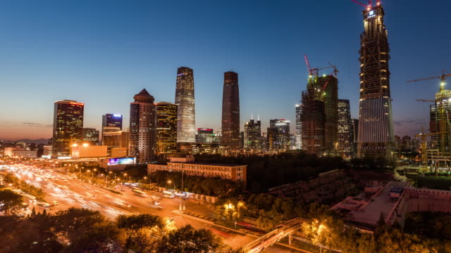 T/L WS HA PAN Aerial View of Beijing CBD Area, Dusk to Night Transition video