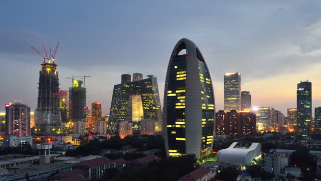 Aerial View of Beijing City Skyline and CCTV Headquarters, Day to Night Transition video