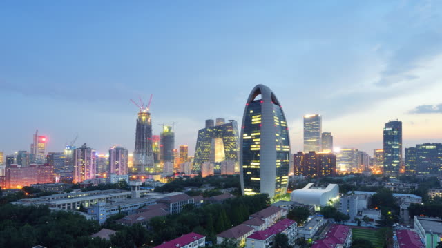Aerial View of Beijing City Skyline and CCTV Headquarters, Day to Night Transition, Zoom video