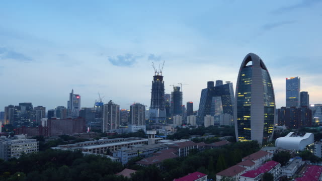Aerial View of Beijing City Skyline and CCTV Headquarters, Day to Night Transition, Panning video